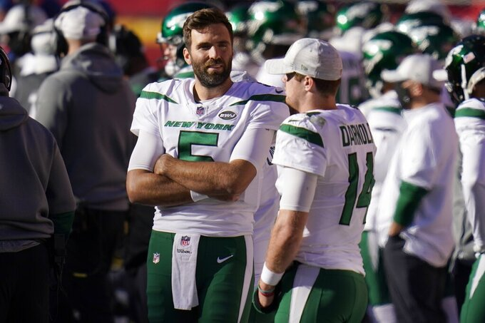 New York Jets' Joe Flacco (5) and Sam Darnold (14) talk on the sideline late in the second half of an NFL football game against the Kansas City Chiefs on Sunday, Nov. 1, 2020, in Kansas City, Mo. (AP Photo/Jeff Roberson)