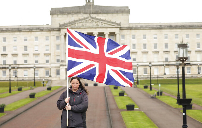 A Loyalist protester opposed to the Northern Ireland Protocol on Brexit makes a political point outside parliament buildings, Stormont, Belfast, Northern Ireland, Thursday, April 8, 2021 . (AP Photo/Peter Morrison)