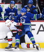 Ottawa Senators' Magnus Paajarvi, left, of Sweden, and Vancouver Canucks' Jake Virtanen collide during the second period of an NHL hockey game Wednesday, March 20, 2019, in Vancouver, British Columbia. (Darryl Dyck/The Canadian Press via AP)