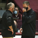 Virginia Tech head coach Mike Young, left, and VMI head coach Dan Earl talk at the conclusion of an NCAA college basketball game, Thursday, Dec. 3, 2020 in Blacksburg, Va. (Matt Gentry/The Roanoke Times via AP, Pool)