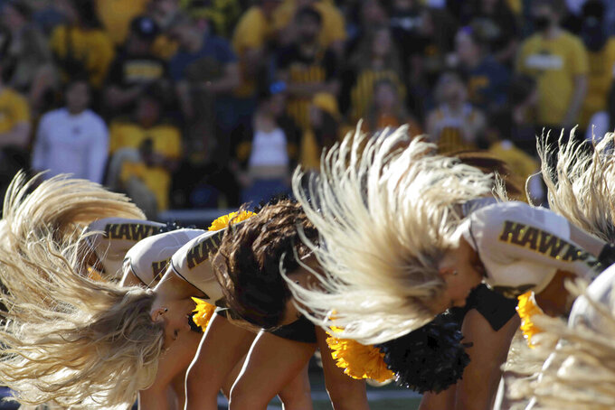 The Iowa dance team performs during the second half of an NCAA college football game against Colorado State, Saturday, Sept. 25, 2021, in Iowa City, Iowa. (AP Photo/Ron Johnson)