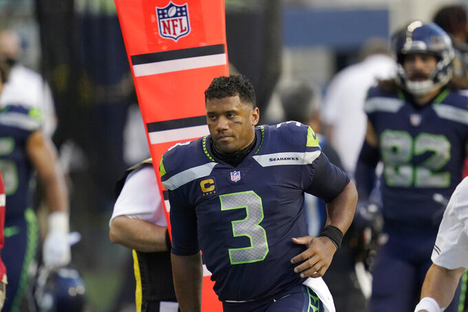 Seattle Seahawks quarterback Russell Wilson heads to the locker room at half time of an NFL football game against the New England Patriots, Sunday, Sept. 20, 2020, in Seattle. (AP Photo/Elaine Thompson)