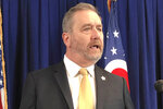 FILE - In this Feb. 20, 2020 file photo, Ohio Attorney General Dave Yost, speaks in Columbus, Ohio, Without major changes in almost every state, a national police misconduct database like what the White House and Congress have proposed after George Floyd's death would fail to account for thousands of problem officers.