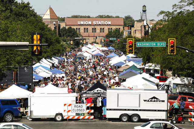 Crowds gather during the season's first Farmers Market Ogden on Historic 25th Street, Saturday, June 24, 2017, in Ogden, Utah. The city is considering an idea that would temporarily close the street to vehicular traffic so restaurants could utilize the extra space for social distancing during the COVID-19 pandemic. (Matt Herp/Standard-Examiner via AP)