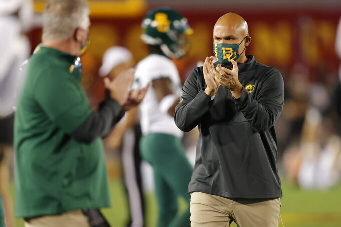 Baylor coach Dave Aranda applauds as players warm up for the team's NCAA college football game against Iowa State, Saturday, Nov. 7, 2020, in Ames, Iowa. (AP Photo/Matthew Putney)