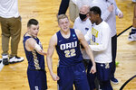 Oral Roberts forward Francis Lacis (22) celebrates after a college basketball game against Florida in the second round of the NCAA tournament at Indiana Farmers Coliseum, Sunday, March 21, 2021 in Indianapolis. Oral Roberts won 81-78. (AP Photo/AJ Mast)