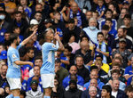 Manchester City's Gabriel Jesus, right, celebrates with Manchester City's Bernardo Silva after scoring his side's opening goal during the English Premier League soccer match between Chelsea and Manchester City at Stamford Bridge Stadium in London, Saturday, Sept. 25, 2021. (AP Photo/Alastair Grant)