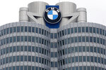 FILE - In this Wednesday, March 21, 2018 file photo, the logo of German car manufacturer BMW is pictured at the headquarters in Munich, Germany. German automaker BMW AG lost 212 million euros, $250 million, in the second quarter as the coronavirus pandemic shutdowns cut vehicle sales by a quarter in the April-June period. (AP Photo/Matthias Schrader, file)