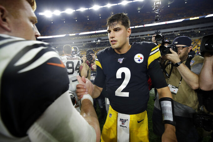 Pittsburgh Steelers quarterback Mason Rudolph (2) and Cincinnati Bengals quarterback Andy Dalton meet on the field following an NFL football game in Pittsburgh, Monday, Sept. 30, 2019. (AP Photo/Don Wright)