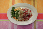 In this Sept. 10, 2019 photo, a chile en nogada, topped with parsley, walnuts, and pomegrante seeds to resemble the Mexican flag, is delivered to a diner at El Sabor, a family-owned restaurant inside Juarez Market that for decades has been serving up chiles en nogada in the weeks leading up to Mexico's independence celebrations, in Mexico City. Although the 200 peso ($10.50) price tag at El Sabor is half that at high end restaurants, the traditional ingredients and hours of labor that go into making the sweet and salty dish mean it is still the priciest item on their menu, a seasonal treat for fans of the dish. (AP Photo/Rebecca Blackwell)