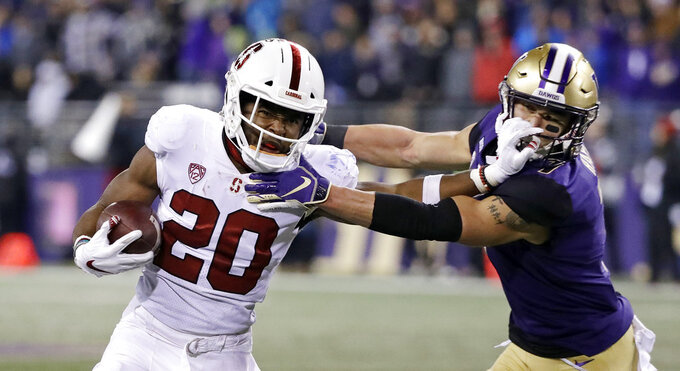 Stanford's Bryce Love (20) pushes back on Washington's Taylor Rapp on a carry during the second half of an NCAA college football game Saturday, Nov. 3, 2018, in Seattle. Rapp was called for a horse collar on the play. Washington won 27-23. (AP Photo/Elaine Thompson)