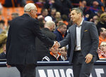 Virginia head coach Tony Bennett, right, shakes hands with Syracuse head coach Jim Boeheim after an NCAA college basketball game in Syracuse, N.Y., Monday, March 4, 2019. (AP Photo/Adrian Kraus)