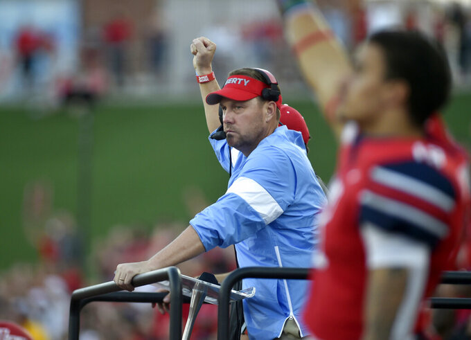 Liberty coach Hugh Freeze celebrates after a touchdown against Hampton during a college football game in Lynchburg, Va., Saturday, Sept. 21, 2019. (Taylor Irby/The News & Advance via AP)