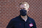Oklahoma ead coach Lincoln Riley, talks with the media after on a short campus march with his team to protest racial injustice in Norman, Okla., Friday, Aug. 28, 2020. (AP Photo/Sue Ogrocki)