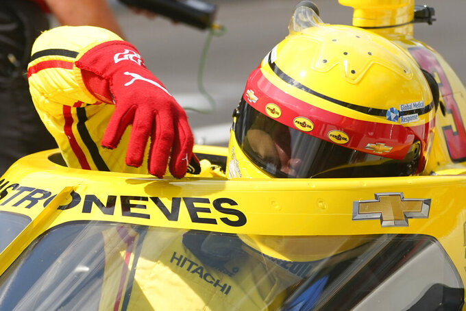 Helio Castroneves, of Brazil, climbs out of his car during qualifications for the Indianapolis 500 auto race at Indianapolis Motor Speedway, Saturday, Aug. 15, 2020, in Indianapolis. (AP Photo/Darron Cummings)