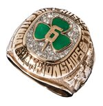 This photo provided by Hunt Auctions, shows a Boston Celtics NBA basketball championship ring owned by Celtics player and coach, Bill Russell. The most-decorated man in NBA history will soon be giving the public a chance to own some of the prized artifacts from his legendary basketball career. Hall of Famer Bill Russell announced, Thursday, July 22, 2021, that he is offering hundreds of items from his personal collection including trophies, rings, basketballs, jerseys, letters, photos, and other memorabilia at auction. (Mike Freeberg/Hunt Auctions via AP)