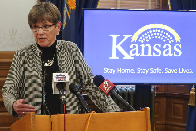 Kansas Gov. Laura Kelly answers reporters' questions about her veto of a sweeping coronavirus bill that would have curbed her power to direct the state's pandemic response during a news conference, Tuesday, May6 26, 2020, at the Statehouse in Topeka, Kan. The Democratic governor issued a new state of emergency and called the Republican-controlled Legislature into special session to extend that state of emergency. (AP Photo/John Hanna)