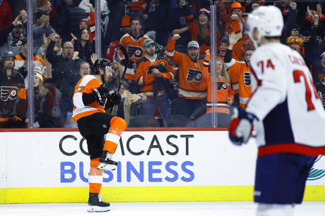 Philadelphia Flyers' Kevin Hayes, left, celebrates his goal, as Washington Capitals' John Carlson watches during the second period of an NHL hockey game Wednesday, Jan. 8, 2020, in Philadelphia. (AP Photo/Matt Slocum)