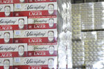 FILE - Cases of canned Yuengling Traditional Lager are stacked in the warehouse of the D.G. Yuengling & Son Brewery Mill Creek plant on Tuesday, July 21, 2020, in Pottsville, Pa. Pottsville, Pennsylvania-based D.G. Yuengling and Son Inc. said Tuesday, Sept. it's forming a joint venture with Molson Coors Beverage Co. to expand distribution of its beers beyond the East Coast. Yuengling, a 191-year-old family-owned brewery known for its cheap German-style lager, will remain independent.(Lindsey Shuey/Republican-Herald via AP, File)