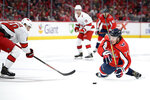 Washington Capitals right wing T.J. Oshie, right, battles for the puck against Carolina Hurricanes center Martin Necas, left, during the second period of an NHL hockey game, Saturday, Oct. 5, 2019, in Washington. (AP Photo/Nick Wass)