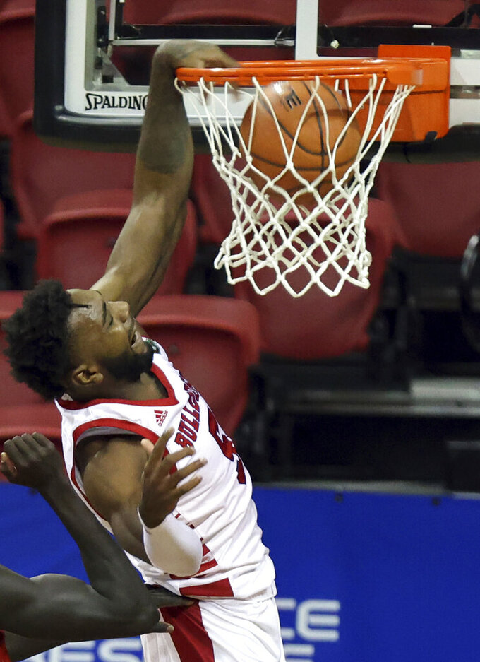 Fresno State guard Jordan Campbell (5) dunks against New Mexico during the first half of an NCAA college basketball game in the first round of the Mountain West Conference men's tournament Wednesday, March 10, 2021, in Las Vegas. (AP Photo/Isaac Brekken)
