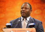 Syracuse head coach Dino Babers answers a question during a news conference at the NCAA Atlantic Coast Conference college football media day in Charlotte, N.C., Thursday, July 19, 2018. (AP Photo/Chuck Burton)