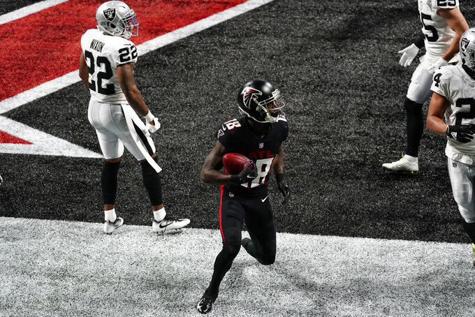 Atlanta Falcons wide receiver Calvin Ridley (18) scores a touchdown against the Las Vegas Raiders during the first half of an NFL football game, Sunday, Nov. 29, 2020, in Atlanta. (AP Photo/Brynn Anderson)