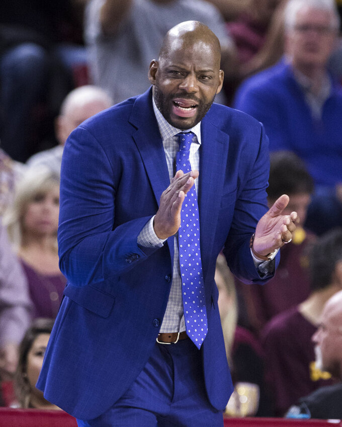 California head coach Wyking Jones encourages his team as they comeback against Arizona State during the first half of an NCAA college basketball game Sunday, Feb. 24, 2019, in Tempe, Ariz. (AP Photo/Darryl Webb)