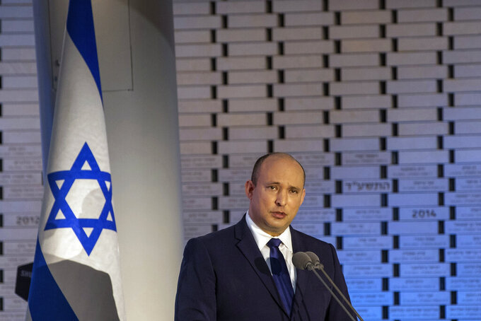 Israeli Prime Minister Naftali Bennett speaks during a memorial ceremony on the 48th anniversary of the Yom Kippur War between Israel and Arab states in 1973, at Mt. Herzl in Jerusalem, Sunday, Sept. 19 2021. (Ohad Zwigenberg/Pool via AP)
