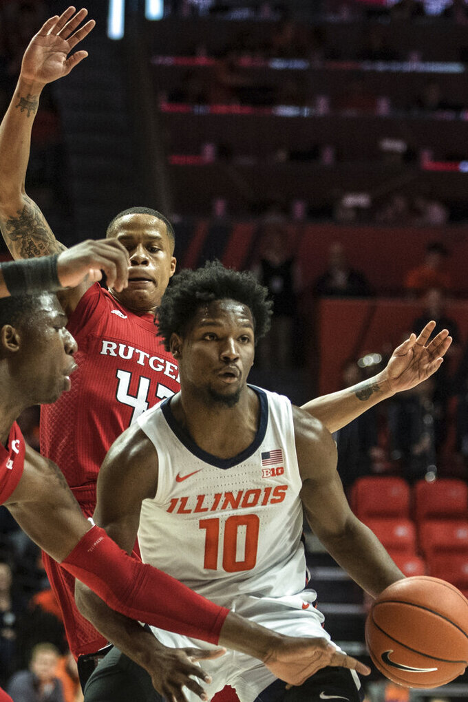 Illinois' Andres Feliz (10) is pressured by Rutgers' Shaq Carter(13) and Jacob Young (42) in the first half of an NCAA college basketball game, Sunday, Jan. 11, 2020, in Champaign, Ill. (AP Photo/Holly Hart)