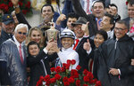 Mike Smith celebrates after riding Justify to victory during the 144th running of the Kentucky Derby horse race at Churchill Downs Saturday, May 5, 2018, in Louisville, Ky. (AP Photo/John Minchillo)