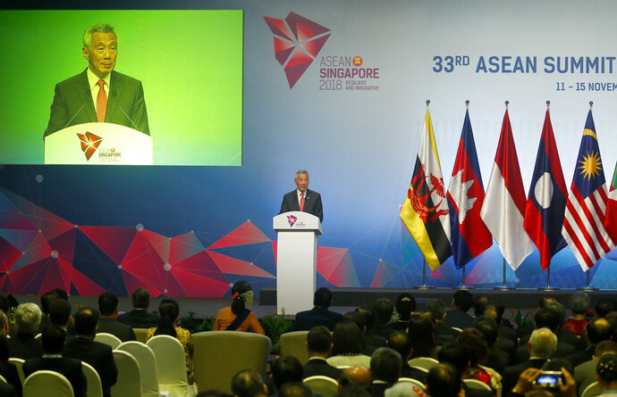 Singapore's Prime Minister Lee Hsien Loong addresses delegates during the opening ceremony for the 33rd ASEAN Summit and Related Summits Tuesday, Nov. 13, 2018, in Singapore. The summit is expected to discuss the South China Sea issue, maritime security and terrorism. (AP Photo/Bullit Marquez)