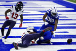 Indianapolis Colts running back Jonathan Taylor (28) looks to a fumble by Houston Texans wide receiver Keke Coutee (16) in the end zone in the final minute of the second half of an NFL football game in Indianapolis, Sunday, Dec. 20, 2020. (AP Photo/AJ Mast)