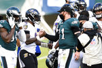 Philadelphia Eagles' Carson Wentz, right, and Baltimore Ravens' Lamar Jackson meet after an NFL football game, Sunday, Oct. 18, 2020, in Philadelphia. (AP Photo/Derik Hamilton)