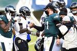 Philadelphia Eagles' Carson Wentz, right, and Baltimore Ravens' Lamar Jackson meet after an NFL football game, Sunday, Oct. 18, 2020, in Philadelphia. (AP Photo/Derik Hamilton)