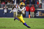FILE - In this Nov. 16, 2019, file photo, LSU running back Clyde Edwards-Helaire (22) runs the ball during the first half of an NCAA college football game against Mississippi, in Oxford, Miss. Clyde Edwards-Helaire was one of three players from LSU's high-powered offense to earn unanimous first-team all-SEC honors when The Associated Press All-Southeastern Conference football team was announced Monday, Dec. 9, 2019. (AP Photo/Thomas Graning, File)