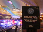 This June 24, 2020 photo shows a sign in the Hard Rock casino in Atlantic City N.J. instructing customers to maintain a distance on the escalator to prevent the spread of the coronavirus. Smoking, drinking and eating will all be prohibited when Atlantic City's casinos reopen after being shut for three months due to the coronavirus outbreak under rules imposed by New Jersey Gov. Phil Murphy on June 29, 2020. (AP Photo/Wayne Parry)