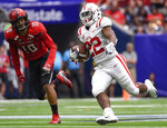 Mississippi running back Scottie Phillips (22) runs past Texas Tech defensive back John Bonney during the second half of a college football game, Saturday, Sept. 1, 2018, in Houston. Mississippi won 47-27. (AP Photo/Eric Christian Smith)