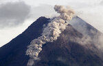 Hot cloud of volcanic materials run down the slope of Mount Merapi during an eruption in Sleman, Wednesday, Jan. 27, 2021. Indonesia's most active volcano erupted Wednesday with a river of lava and searing gas clouds flowing 1,500 meters (4,900 feet) down its slopes. (AP Photo/Slamet Riyadi)