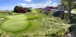Temporary grandstands are setup around the 18th hole at Whistling Straits Golf Course, in Haven, Wis.. Tuesday, Sept. 14, 2021, in preparation for the The Ryder Cup golf matches. The pandemic-delayed 2020 Ryder Cup returns the United States next week at Whistling Straits along the Wisconsin shores of Lake Michigan. (Mike De Sisti/Milwaukee Journal-Sentinel via AP)