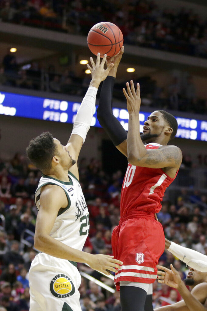 Bradley's Elijah Childs (10) shoots over Michigan State's Kenny Goins (25) during the first half of a first round men's college basketball game in the NCAA Tournament in Des Moines, Iowa, Thursday, March 21, 2019. (AP Photo/Nati Harnik)