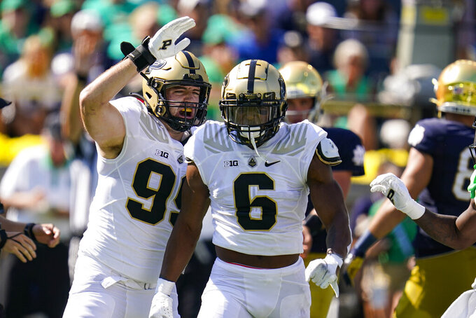 Purdue linebacker Jalen Graham (6) celebrates a sack with defensive end Jack Sullivan (99) during the first half of an NCAA college football game in South Bend, Ind., Saturday, Sept. 18, 2021. (AP Photo/Michael Conroy)