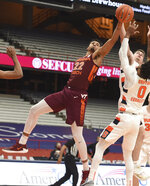 Virginia Tech = forward Keve Aluma (22) reaches for a rebound against Syracuse during an NCAA college basketball game at the Carrier Dome, Syracuse, N.Y., Saturday Jan. 23, 2021. (Scott Schild/The Post-Standard via AP)