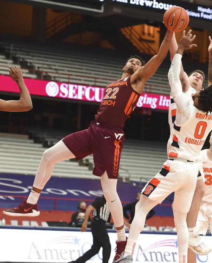Virginia Tech = forward Keve Aluma (22) reaches for a rebound against Syracuse during an NCAA college basketball game at the Carrier Dome, Syracuse, N.Y., Saturday Jan. 23, 2021. (Scott Schild/The Post-Standard via AP)