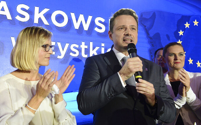 FILE - In this Sunday, Oct. 21, 2018 file photo Warsaw city mayor candidate from the main opposition party Civic Platform, Rafal Trzaskowski speaks to supporters after first exit polls indicating him as the winner are announced in Warsaw, Poland. Trzaskowski, a pro-European Union liberal, has recently joined the race for the nation's president and has emerged as the main challenger to incumbent President Andrzej Duda who had previously seemed certain to win. The date of the vote is yet to be announced. (AP Photo/Alik Keplicz, File)