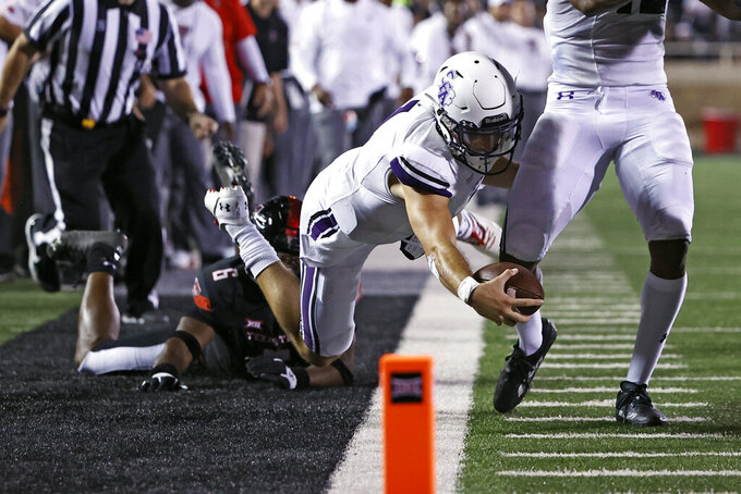oStephen F. Austin's Trae Self (1) stretches out with the ball while being pushed out of bounds by Texas Tech's Riko Jeffers (6) during the second half of an NCAA college football game Saturday, Sept. 11, 2021, in Lubbock, Texas. (AP Photo/Brad Tollefson)