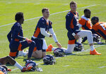Denver Broncos quarterback Teddy Bridgewater (5), Brett Rypien (4) and quarterback Drew Lock (3) talk while stretching during Denver Broncos OTAs at the team's headquarters Monday, May 24, 2021, in Englewood, Colo. (AP Photo/Jack Dempsey)