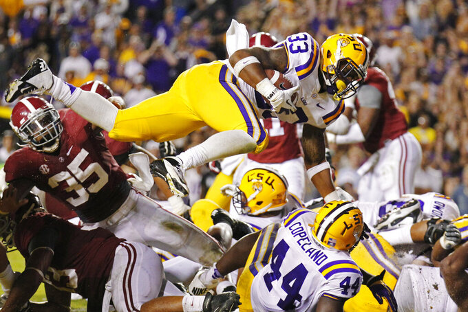 LSU running back Jeremy Hill (33) dives into the end zone for a touchdown against Alabama in the third quarter of an NCAA college football game in Baton Rouge, La., Saturday, Nov. 3, 2012. (AP Photo/Bill Haber)