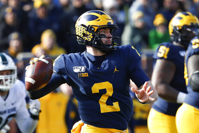 Michigan quarterback Shea Patterson throws a pass in the first half of an NCAA college football game against Michigan State in Ann Arbor, Mich., Saturday, Nov. 16, 2019. (AP Photo/Paul Sancya)
