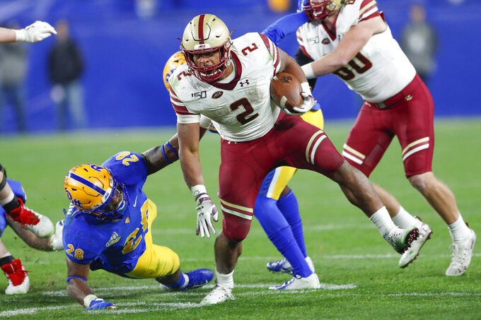 Boston College running back AJ Dillon (2) evades Pittsburgh linebacker Kylan Johnson (28) during the second half of an NCAA college football game, Saturday, Nov. 30, 2019, in Pittsburgh. (AP Photo/Keith Srakocic)